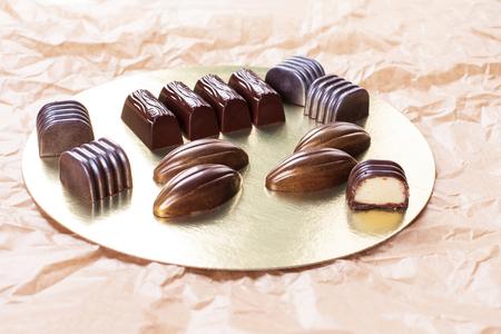 Assorted dark chocolate candies. Stock image.