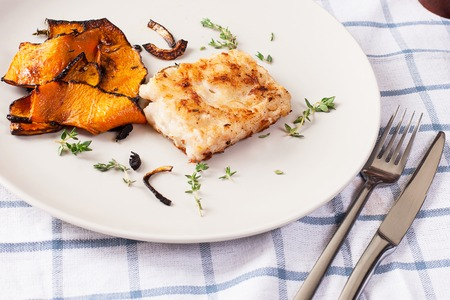 Fried fish fillet and vegetables. Stock image.
