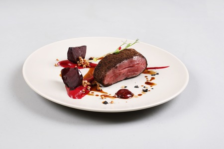 Delicious veal fillet served with sauce, molecular froth and beetroot
