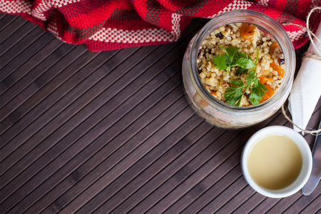 cooked vegan bulgur in a pot on a dark table