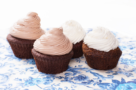 chocolate cupcake on white plate. Stock image. 版權商用圖片