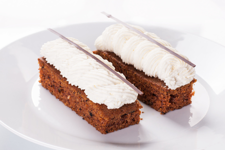 Carrot cake with cream. Stock image.