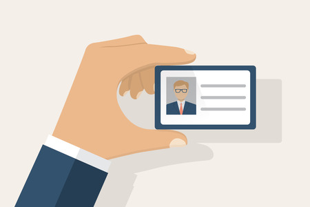 access control: Male businessman holds identification card in hand. With permit. ID Card icon. Vector illustration, flat design style. Personal identification. Access control. Sign id card. Personal document in hand.