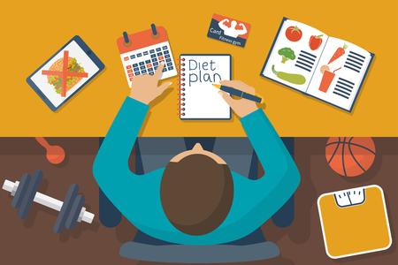 diet plan: Diet plan. Man behind the desk planning diet, healthy lifestyle.
