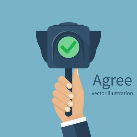 Agree concept. Businessman holding traffic light with a green light, indicating consent. Vector illustration flat design.