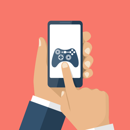 Mobile game concept. Hand holding smartphone, with gaming application on screen. Vector illustration flat design. Icon joystick, controller. Touching finger to display.