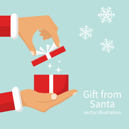 Gift from Santa Claus. Santa Claus holding red gift box in hand, shows open gift. Vector illustration flat design. Merry Christmas and Happy New Year on a snowy background.