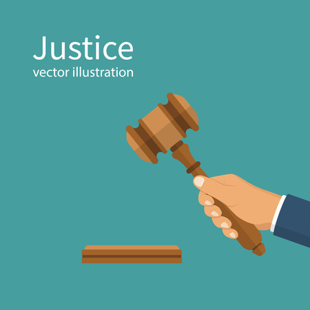 Justice. Hand holding judges gavel Stock Photo