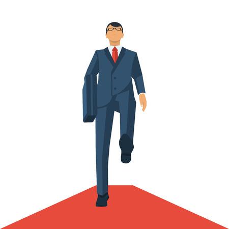 Businessman walking on a red carpet.