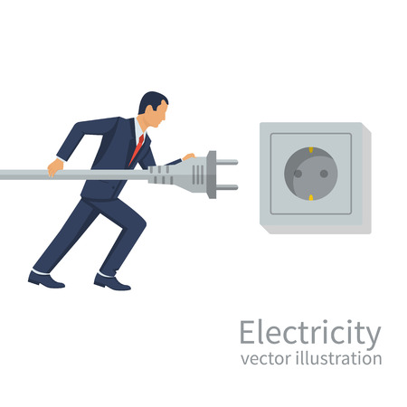 Businessman holding in hand electric power plug.