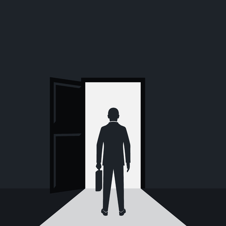 Businessman silhouette walking to opened door