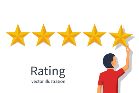 Star rating. Businesswoman holding a gold star in hand, to give Stockfoto