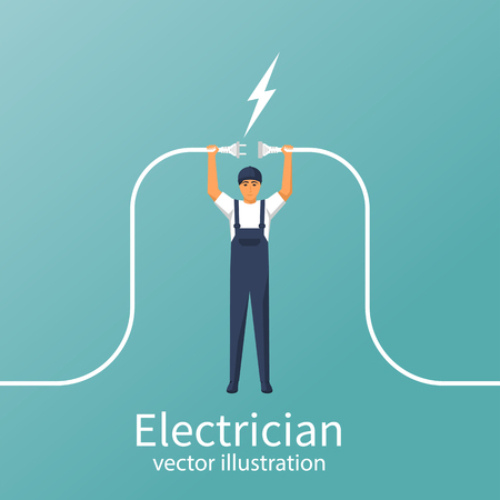 Electrical outlet and plug in the hands of the worker Stock Photo