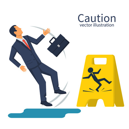 Businessman with a briefcase fell on a wet floor Stock Photo