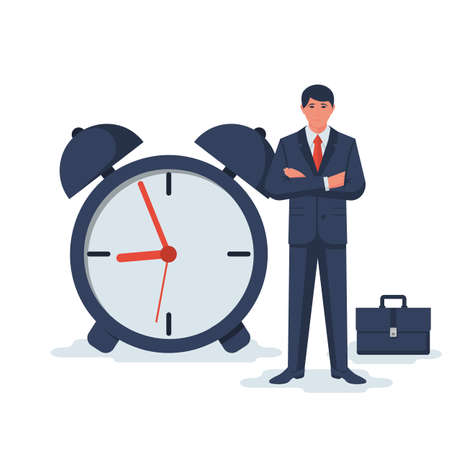 Time control. Confident man is standing near the clock with a suitcase