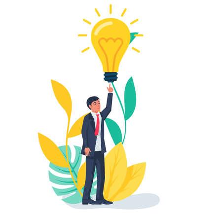 I have an idea landing page. Businessman points to an idea symbol.