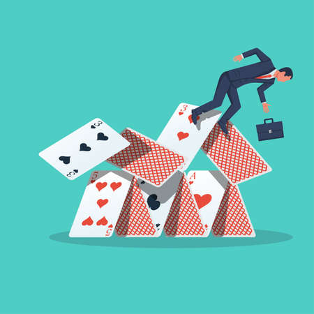 Businessman falls from a house of cards. Shaky position.