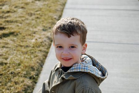 Little boy on the sidewalk Stock Photo