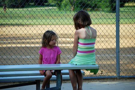 two little girls having a serious talk