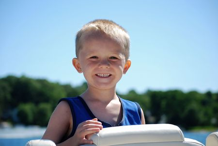happy little boy on the boat Stock Photo
