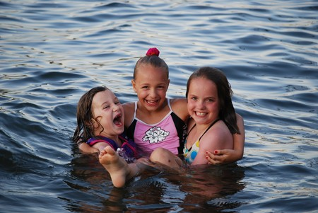 three girls having fun in the water