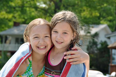 two young girls dry off after swimming Stock Photo