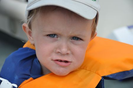 a cute little boy takes a boatride