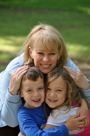 two children enjoy time with their grandmother Stock Photo - 6353033