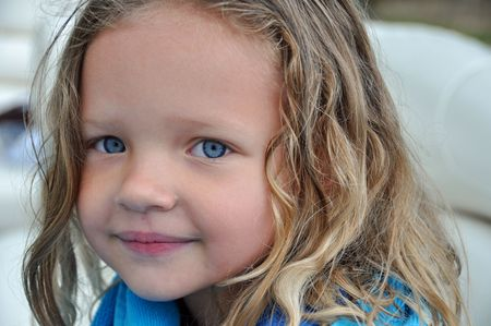 a little girl enjoys a boatride in summer