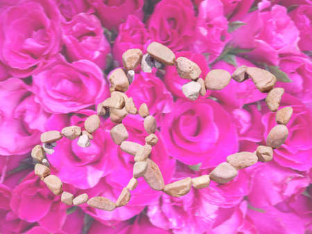 hardscape: lover gravel on pink roses background for valentine concept Stock Photo