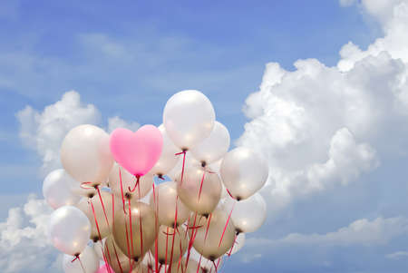heart pink balloon on cloudy sky for valentine day photo