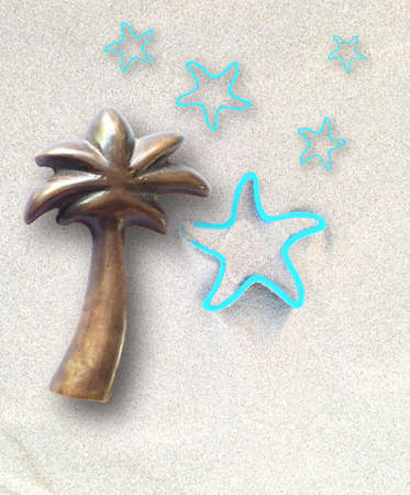 sand mold: concept of summer time with coconut tree and stars Stock Photo