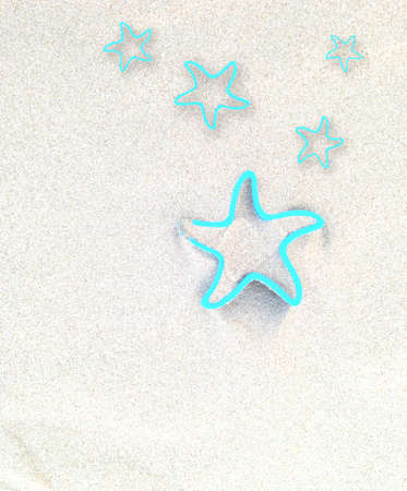 sand mold: concept of summer time with stars