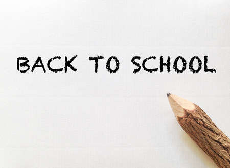 note paper: concept idea for back to school wording on white note paper with pencil Stock Photo