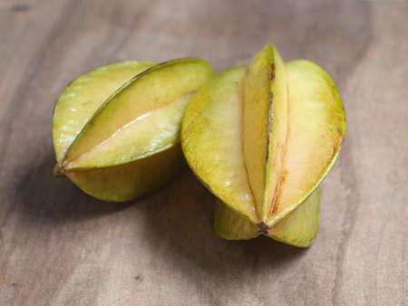 star fruit: star apple or star fruit on wood background Stock Photo