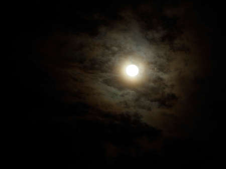 luminous full moon on cloudy sky for halloween concept