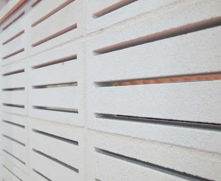 hollow: hollow concrete block wall with stripe pattern