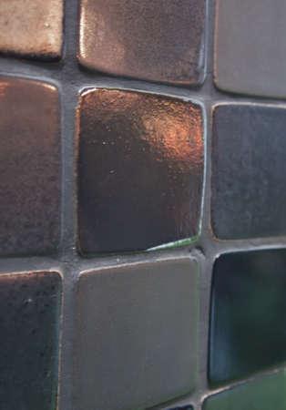 black or dark grey rectangular with curved corner mosaic wall