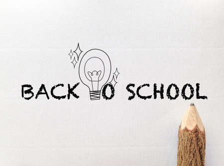 concept idea for back to school wording and light bulb on white note paper with pencil