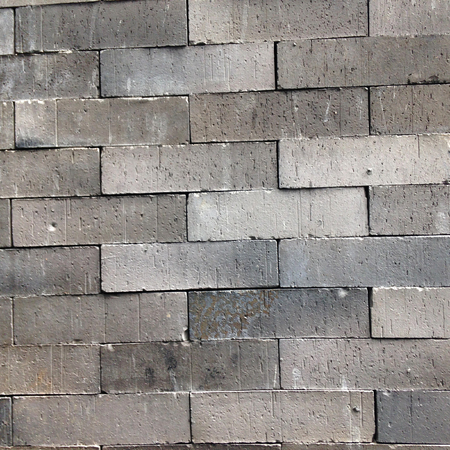 grey brick wall background with running bound