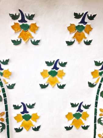 yellow flower mosaic on white cement background or panel Stock Photo