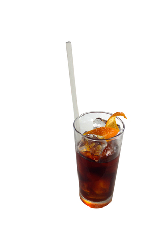 isolated glass of cold brew coffee and orange peel on white background