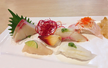 japanese sushi or sashimi in ice bowl or plate with leaf