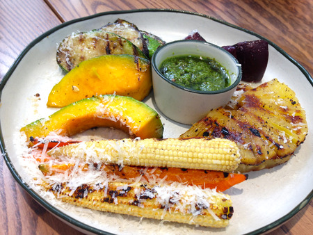 grilled vegetables plate with pesto sauce on white dish