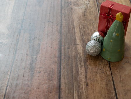 christmas tree and christmas toys on wood plank for merry christmas background with paper space Stock Photo