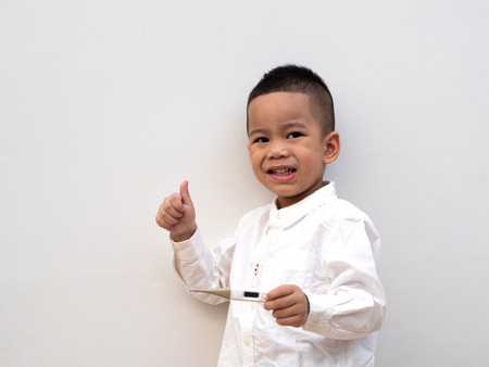 sick asian boy with thermometer in hand get well from fever on white background