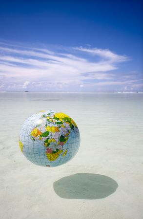 Globe floating in exotic sea Stock Photo - 2925677