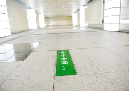 Emergency exit sign in subway station   photo