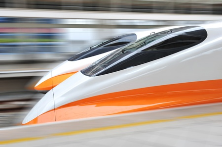 bullet train: two modern train speeding with motion blur.