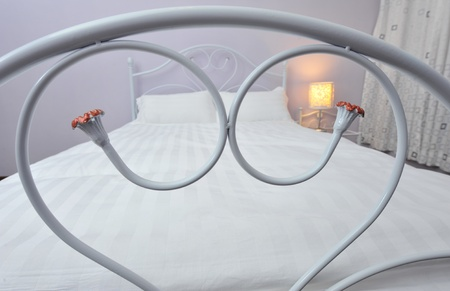 bedstead: King sized bed with heart shape bedstead.